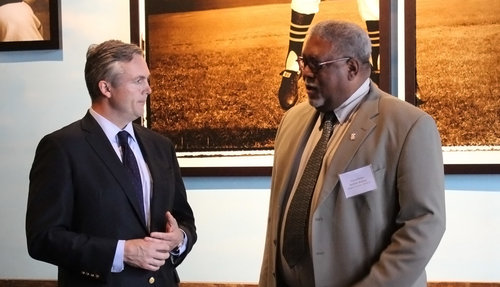 TGPCC President Matt Smith speaks with Allegheny County Councilman DeWitt Walton at the Roberto Clemente Museum in Lawrenceville.